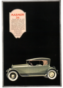 1918 Marmon 34 ad. Green automobile on black background.