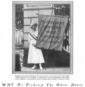 Suffragist holding protest sign, Good Housekeeping, 1918.