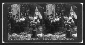 Photograph of people playing cards in a parlor in about 1906.