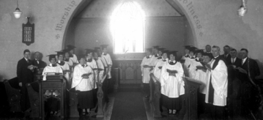 Church choir singing in front of church window, ca. 1918.
