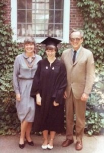 Photograph of Mary Grace McGeehan graduating from Harvard, with parents, 1983.