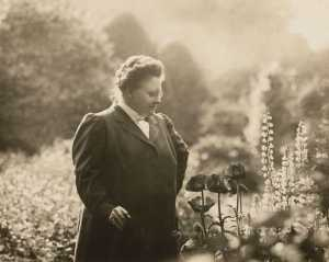 Poet Amy Lowell in her garden, ca. 1916.