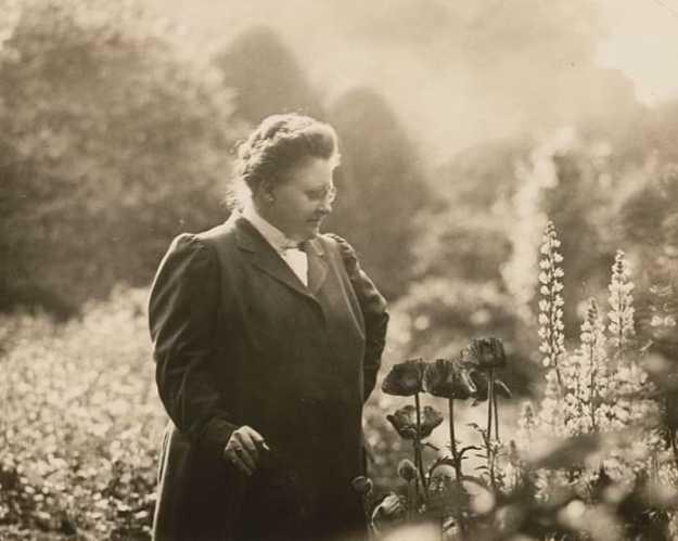 Poet Amy Lowell in her garden, ca. 1916.