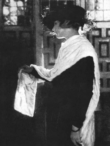 Woman wearing white fur stole, Vanity Fair, December 1918.