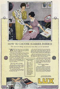 1919 Lux soap ad, How to Choose Summer Fabrics, woman looking at fabric.