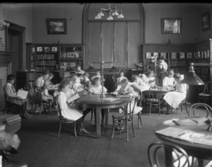 Children reading in library, ca. 1910, William Davis Hassler.
