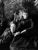 Posed photograph of Selma Lagerlof leaning against Sophie Elkan.