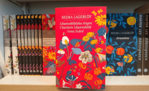 Books by Selma Lagerlof on a bookshelf.