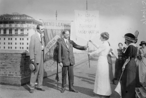 Photograph of Frances Maule Bjorkman with a suffragist banner.