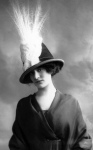 Woman wearing hat with aigret feather, 1911.