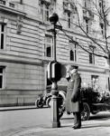 Photograph of policeman at call box, Washington, D.C., 1910s.