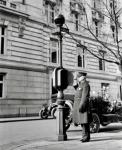 Photograph of policeman at call box, Washington, D.C., 1910s.