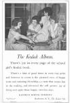 1919 Kodak ad, girls looking at photo album.