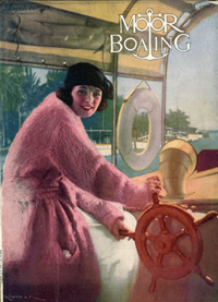 Motor Boating cover, March 1920, woman in pink coat steering wheel of boat.