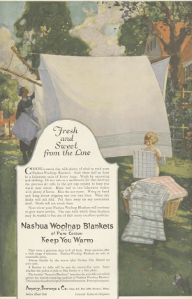 Nashua Wood Blankets ad, maid hanging blankets on line while children fold, Ladies' Home Journal, 1920.