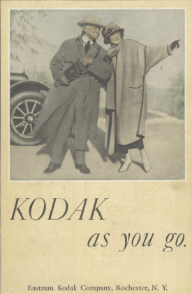 Kodak ad, man and woman next to car, Ladies' Home Journal, 1920.