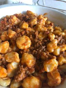 Gnocci with meat sauce.