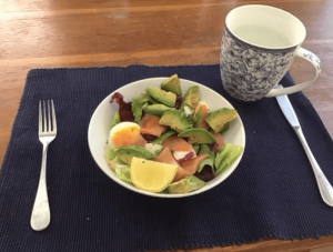Smoked salmon salad with avocado and egg.
