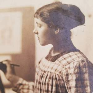 Young Rita Senger at easel, ca. 1910s.